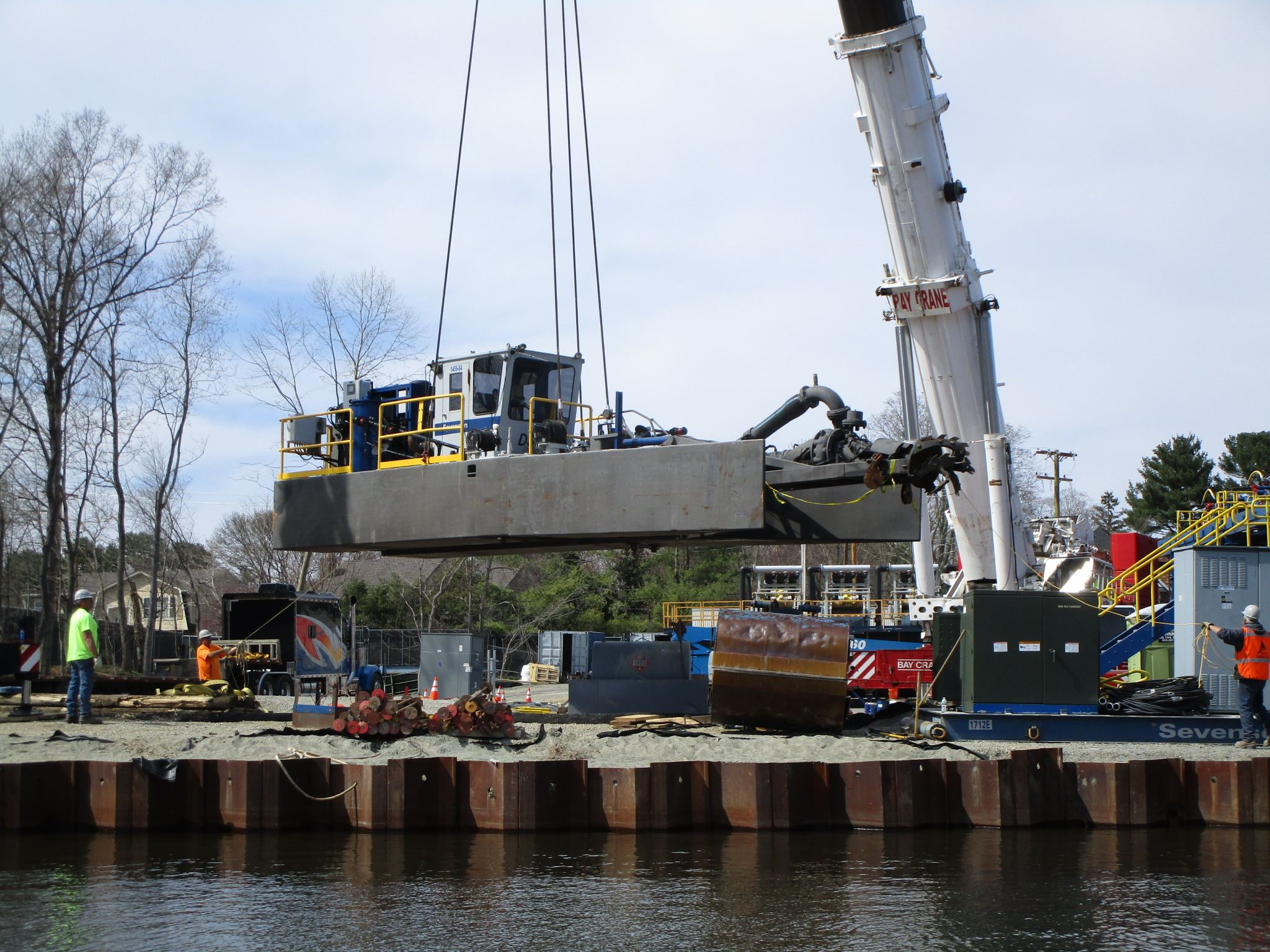 Crane lowering Dredge equipment