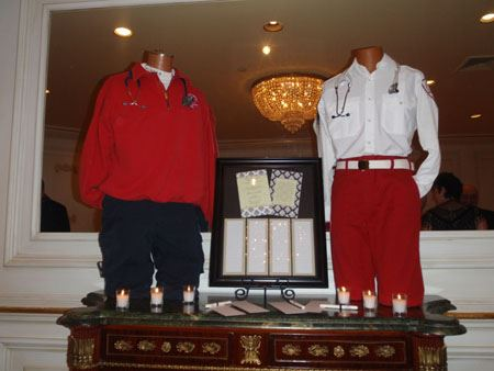 Image of two squad uniforms on mannequins, set on a table with flyers